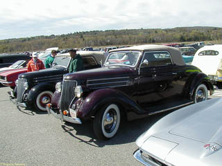 Side by side 1936 Ford cabriolets. The one behind has been lowered.