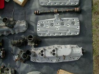 After market Ford flathead V8 heads and dual carburetor intake manifold made by Sharp